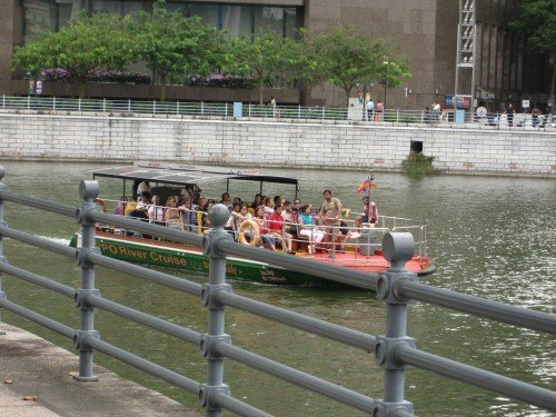 some tourists on a boat sponsored by a tourist guide company