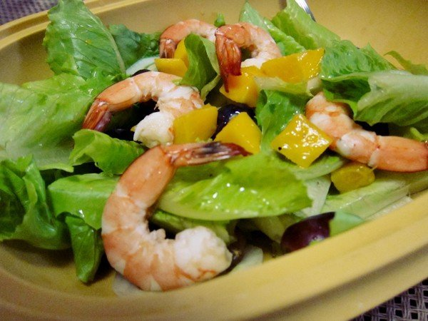 salad with shrimp, mangoes, grapes, and lettuce