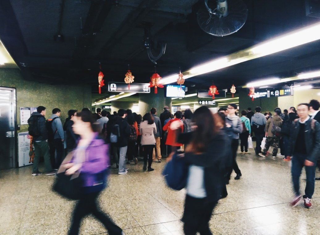 a busy subway in hong kong